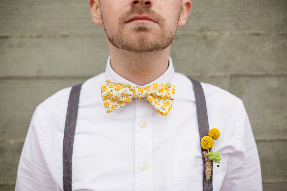 Groomsman with Succulent and Billy Ball Boutonniere